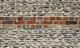 Cegła i flintstone ściana Zdjęcia Royalty Free
