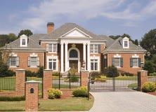 cegły ogrodzenie domu żelaza Obraz Royalty Free