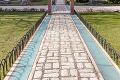 Cegła Kamienny bruk na ziemi dla Ulicznej drogi chodniczek zdjęcia stock