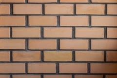 Ceglana symmetric ściana, pomarańcze i popielaty colour, horyzontalny strzał robić od normalnego kamera kąta obraz stock