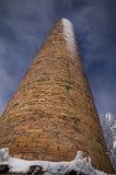 Ceglany komin w zimie Zdjęcie Royalty Free