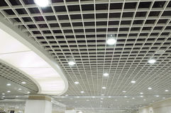 Ceiling. Modern white grid ceiling with lights Stock Photo
