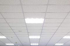 Ceiling. Office ceiling with fixtures and fire sensors stock photo
