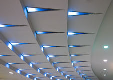 Ceiling. Triangular blue lights on a stepped ceiling Royalty Free Stock Image
