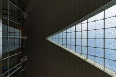 Ceiling abstract shape grid glass frame light shadow modern triangle beams corridors up view lines guide Royalty Free Stock Photo