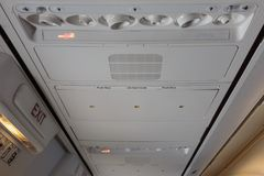 Ceiling of Aircraft Interiors with Lights and Push Buttons for E. Mergency Vests Royalty Free Stock Photo