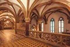 Ceiling and arches of gothic style New Town Hall, Neues Rathausbuilt in 1908. Munich. MUNICH, GERMANY - NOVEMBER 17, 2017: Ceiling and arches of gothic style New Royalty Free Stock Photo