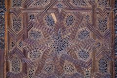 Ceiling with carved wooden pattern in Madrasa Bou Inania wooded royalty free stock photos