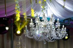 Ceiling chandelier of classic vintage style shape. Made of crystal and glass with candle shaped lamps stock images