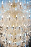 Ceiling chandelier of classic vintage style shape. Made of crystal and glass with candle shaped lamps stock photography