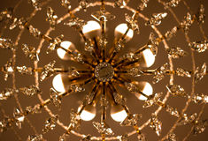 Ceiling chandelier. Electric crystal ceiling chandelier with beautiful ornaments Royalty Free Stock Images
