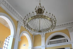 The ceiling of the church with a chandelier. Hanging from the chandeliers Stock Image