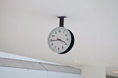 Ceiling Clock in a corridor Royalty Free Stock Photography