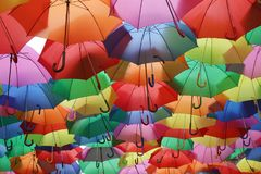 Umbrella Colors. Ceiling of colorful umbrellas over a street royalty free stock photo