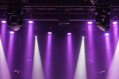 The ceiling of the concert stage with purple and white spotlights on the stage farm. A view from above of the ceiling of a concert stage with purple and white stock image