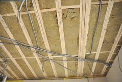 Ceiling construction detail. Close up on ceiling construction details with electricity wire. Building construction gypsum plaster Stock Images