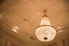 Ceiling crystal chandelier in luxury room Stock Photos