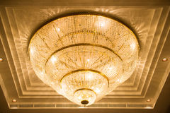Ceiling crystal chandelier in luxury room Royalty Free Stock Image