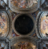 Ceiling decorated with paintings. Ceiling of a church in Rome, decorated with paintings Stock Images