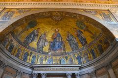 Ceiling decoration at Basilica Papale San Paolo fuori le Mura. St Paul's outside the Walls is one of Rome's four great Basilicas. This mosaic decoration adorns Royalty Free Stock Photo