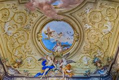 Decoration in the Room of Ladies Court at Royal Palace in Casert. Ceiling decoration in the Hall of Ladies Court at Royal Palace in Caserta, Italy Royalty Free Stock Photos