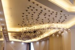 Ceiling decoration with lamps. Modern space decoration,ceiling with lamps stock photo