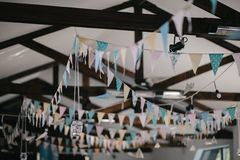 Ceiling decoration with paper flags and lightbulbs Stock Photo