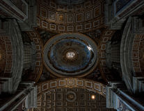 Ceiling decoration in St. Peters' Basilica. Decorated ceiling in the St. Peters' Basilica in Rome, Italy Royalty Free Stock Photography