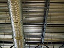 Ceiling Duct. Metal ceiling duct, wires and beams in a clothing store Royalty Free Stock Image