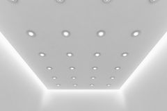 Ceiling of empty white room with small round ceiling lamps. Abstract architecture white room interior - ceiling of empty white room with white wall, white floor Royalty Free Stock Photos