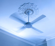 Ceiling Fan. A ceiling fan spinning with a blue tone Stock Photos