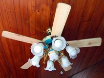 Ceiling Fan. On wood panel ceiling stock photography