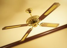 Ceiling fan. Country style ceiling fan in modern house indoors royalty free stock images