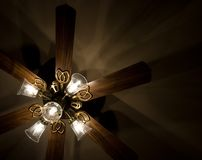 Ceiling Fan With Lights. Lighted ceiling fan, showing shadows on ceiling Stock Photo