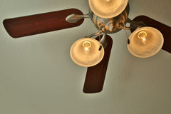 Ceiling fan with lights on background stock photos