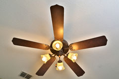 Ceiling fan with lights on. Hanging in the room Royalty Free Stock Photo