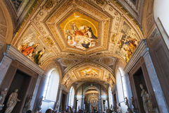Ceiling of Gallery of the Candelabra in Vatican. VATICAN, ITALY - NOVEMBER 2, 2016: tourists take photo of ceiling Gallery of the Candelabra in Pio-Clementino Royalty Free Stock Images