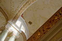 Ceiling with a gold ornament Royalty Free Stock Photo