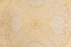 Ceiling with a gold ornament Royalty Free Stock Image