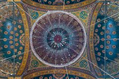 Ceiling of the great Mosque of Muhammad Ali Pasha decorated with golden and blue floral patterns, Citadel of Cairo in Egypt. Ceiling of the great Mosque of royalty free stock image