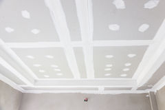 Ceiling gypsum board. Build gypsum board ceiling in construction site Stock Photos