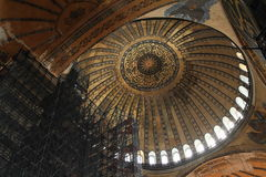Ceiling of Hagia Sofia in Istanbul. Decorated ceiling with Islam painted writings and scaffolding for reconstruction of former church and mosque and current Royalty Free Stock Photography
