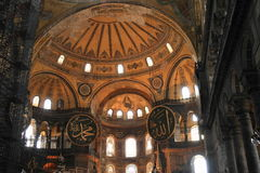 Ceiling of Hagia Sofia in Istanbul. Decorated ceiling with Islam painted writings and scaffolding for reconstruction of former church and mosque and current Stock Image