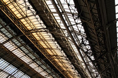Ceiling indoor railway station in Lvov. Roof detail of railway station in Lvov. Arch vault, rivet steel framework with windows Stock Photos