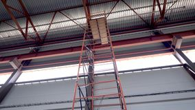 Ceiling industrial hangar or warehouse. High ceiling, serious metal construction. The build. Continues stock footage