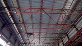 Ceiling industrial hangar or warehouse. High ceiling, serious metal construction. The build. Continues stock video footage