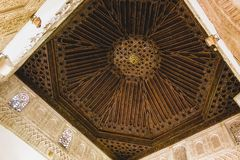 Ceiling with intricate sculpted details of moorish arabian origins royalty free stock image