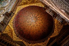 Ceiling with intricate sculpted details of moorish arabian origins stock photography