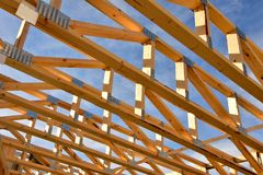 Free Ceiling Joists And Rafters Of New Home Under Construction. Royalty Free Stock Photos - 161381698