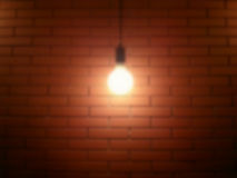 Ceiling lamp blur. Ceiling lamp and red brick wall blur Stock Photos